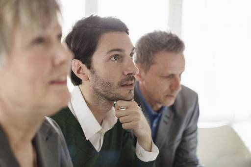 the men thinking in conference