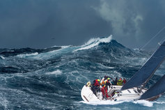 Yacht sailing on rough ocean waves