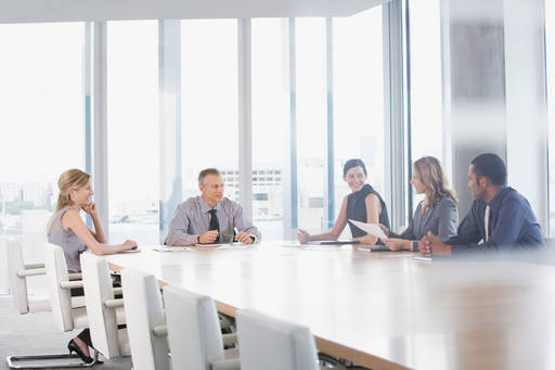 Business people discussing in the board room