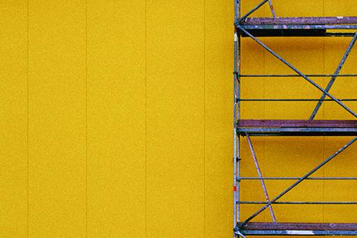 Ladder on yellow wall