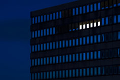lighted windows in office building at night