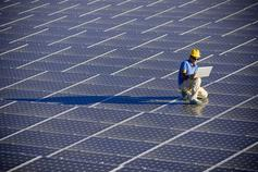 Man working on solar panel