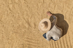Overhead view of a farmer sifting through wheat