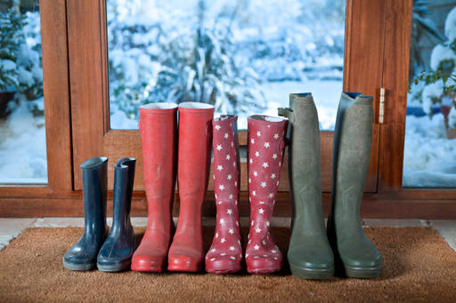 A family's rain boots lined up