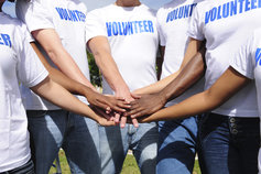 Volunteers gathering hands