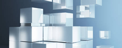 Glass blocks floating in front of a blue/grey background