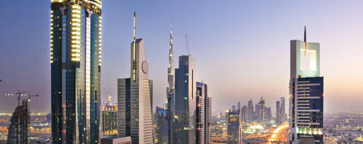 A busy street in dubai at sunset