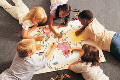 children coloring a map