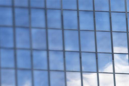 Clouds reflected by mirrored windows