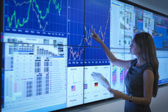 Businesswoman looking at data on a large screen