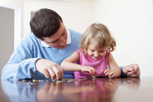 man and child counting coins