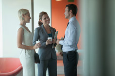 businesswomen and businessman speaking