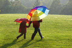 parent child holding colorful umbrellas