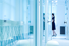 Woman entering a meeting room