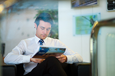 Businessman reading a brochure