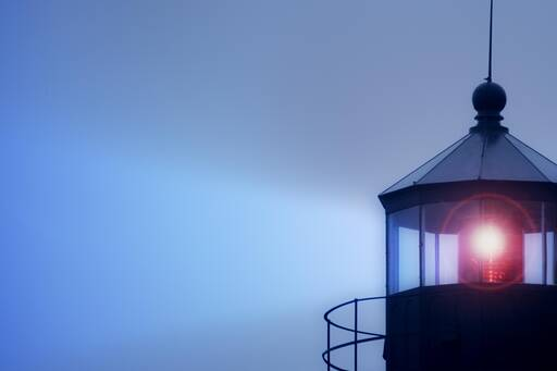Lighthouse with glowing lamp