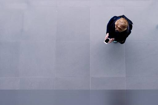 Header image of a woman holding her phone