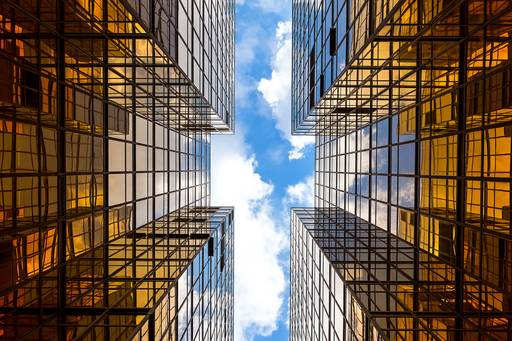 High rising buildings showing  blue sky at top