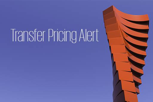 Transfer Pricing Alert banner next to the tower