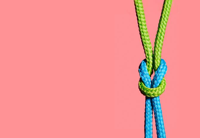 knotted rope on pinck background economic substance