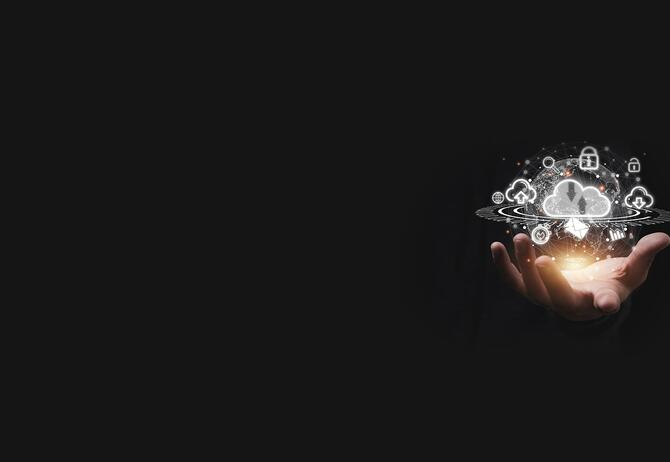 hand with digital icons on dark background