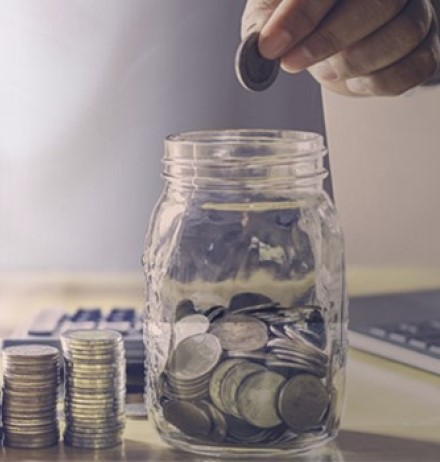 Banner of coins in a jar and on desk