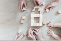 Family playing with wooden blocks
