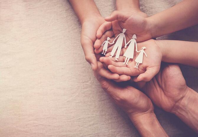 People hand on one another family