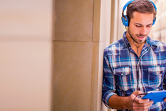 Simplifying and modernising the user experience - man with headphones and tablet