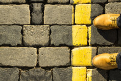 Man standing behind yellow line - Data, privacy and crossing the line