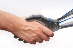 Man shaking hands with robot