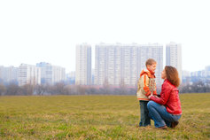 Social housing: let's talk about the customer - image of woman and child in a field