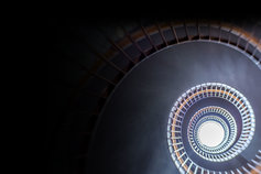 Open minds - Rethinking business in an era of convergence - image of a spiral staircase upward view