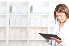 Prescription for change – meeting evolving consumer needs - Women in white coat looking at tablet