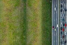 Managed Services - Our Journey - cars on a motorway with large green field on the left hand side