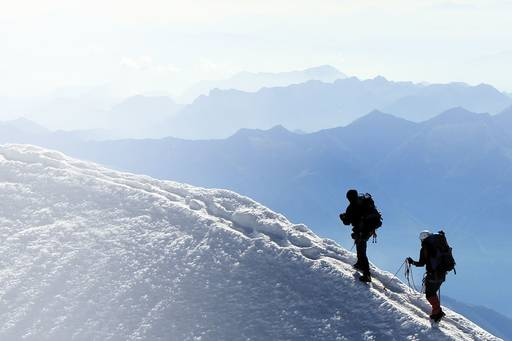 Six steps to Brexit-proof your licence - two explorers walking along a snowfilled mountain