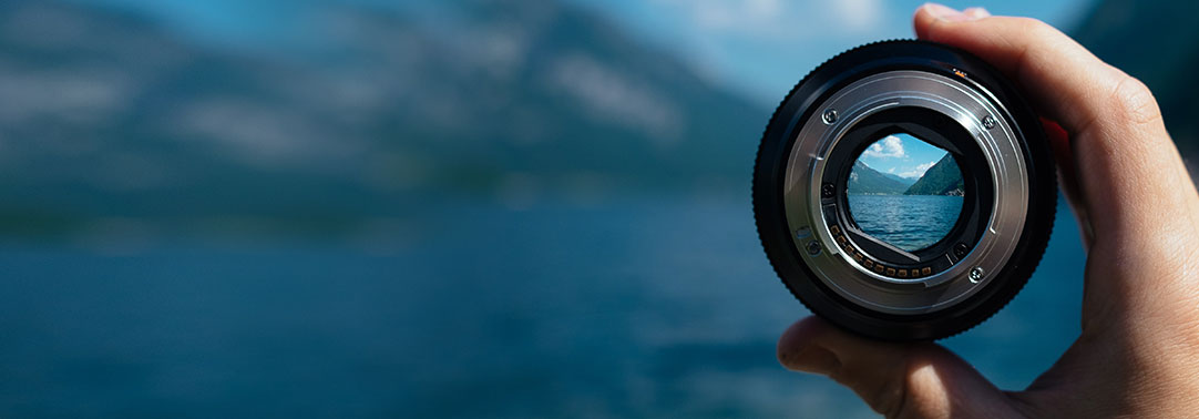 Camera lens and mountain background