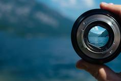 Industry 4.0: How to invest in enhanced performance with confidence and clarity - camera lens with mountain background
