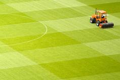 Brexit: Ready for the second half - image of a mower on a football pitch