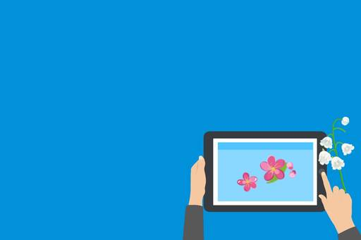 Interim Digital Economy Tax Report approved by OECD, iPad with spring flowers