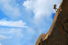 Requirement to correct: Present and correct - photo of man climbing rocks