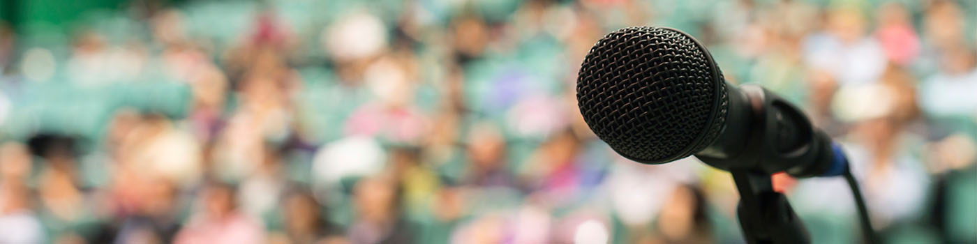 Latest press releases - microphone in front of audience