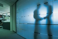 Burying Bribes in the Books and Records - silhouettes behind glass wall
