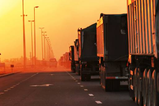 lorries driving into the sunset