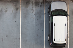 Emissions testing putting the brake on car dealer profitability - Image of car from aerial view