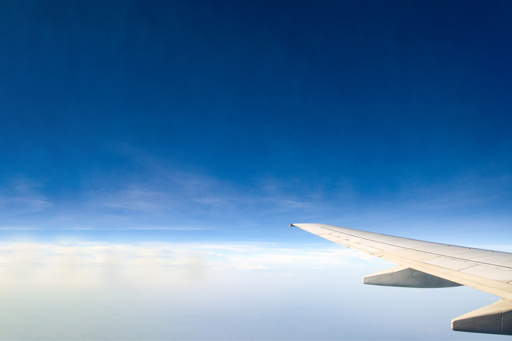 plane-flying-clouds
