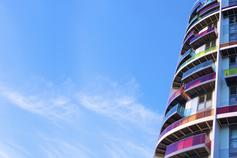 How can estate agents retain competitiveness and profitability? - photo of a colourful building