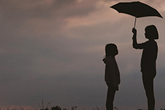 General Insurance Pricing Practices - Girl holding umbrella