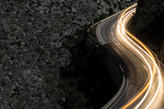 How consolidation can smooth the pensions journey - photo of road with lights