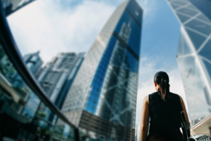 Build a dynamic future for your business - Woman in front of buildings